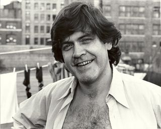 John McCarthy on the roof; photo by Jesse Winch, 1970s