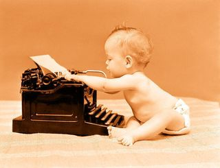 Baby-at-typewriter-peach